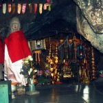 An altar between huge boulders is housed inside the ruin.,
