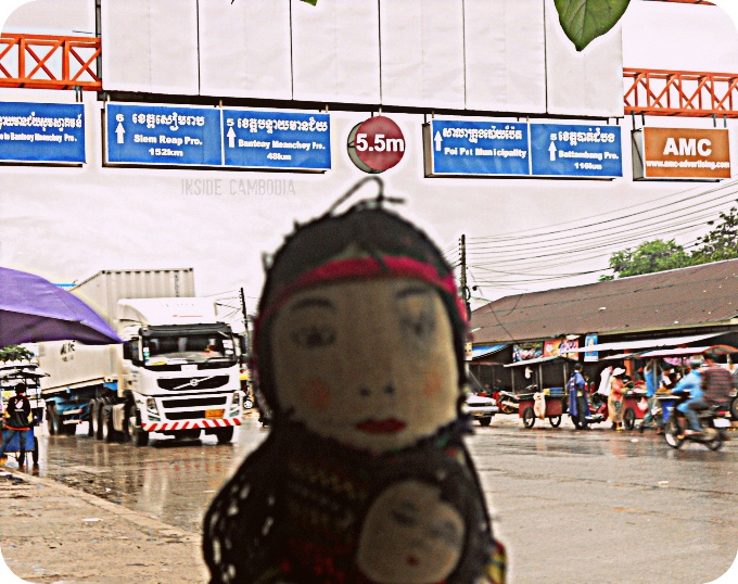 Miss Igorota in front of the big sign located less than 10kms from the immigration office of Poipet.