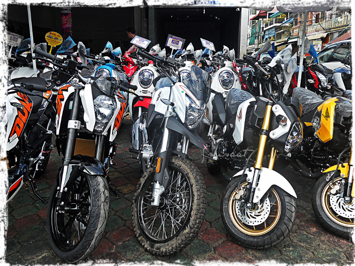 A lot of motorcyle bikes for sale along Sihanouk Boulevard.