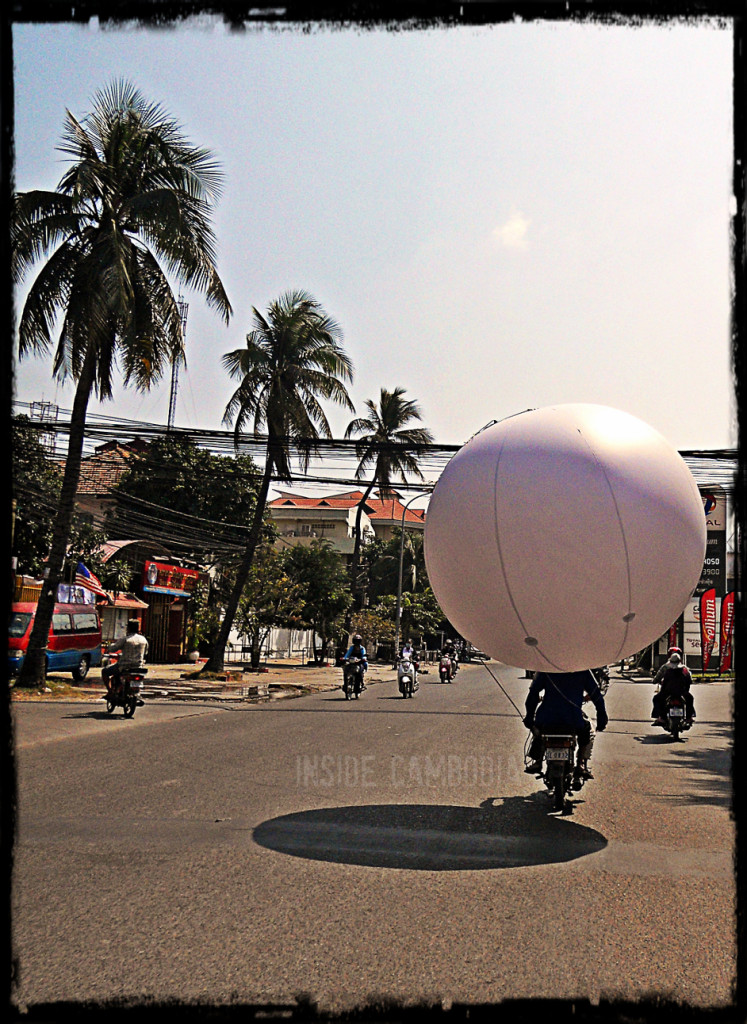 Balloon on a moto in Phnom Penh.